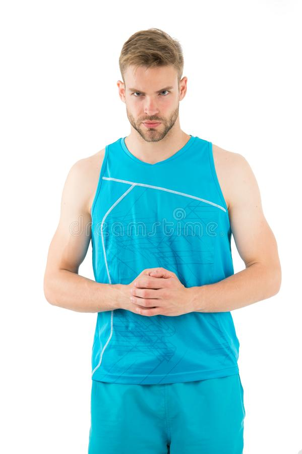Sport is the way of his life. Man sporty outfit looks serious and strict white background. Guy muscular body live stock image