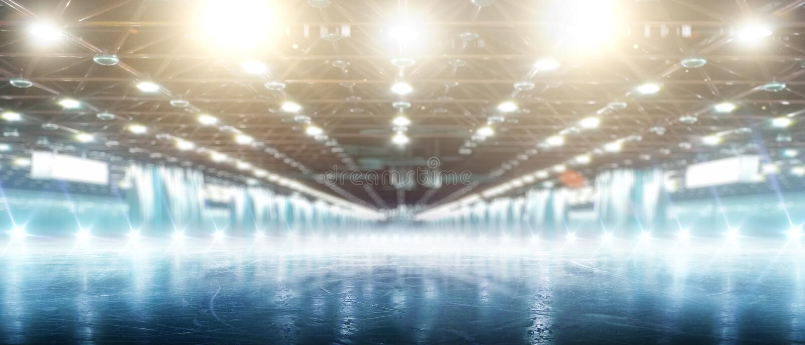 Sport. Winter rink in the spotlights. Empty winter background and empty ice rink with ice and lights stock images