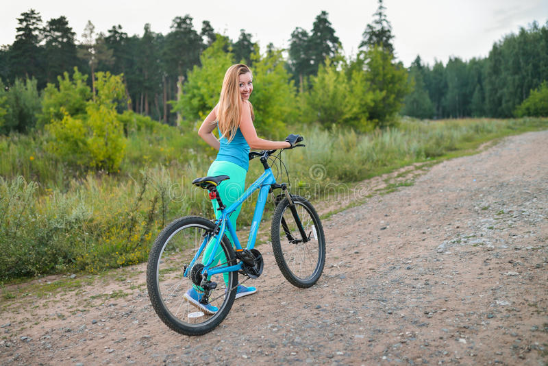 Sport woman with bike enjoy summer vacation, active lifestyle.  royalty free stock photography