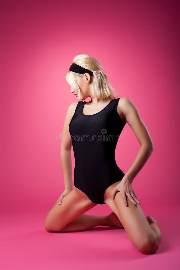 Sport Woman In Black Swim Body Posing On Pink Royalty Free Stock Image