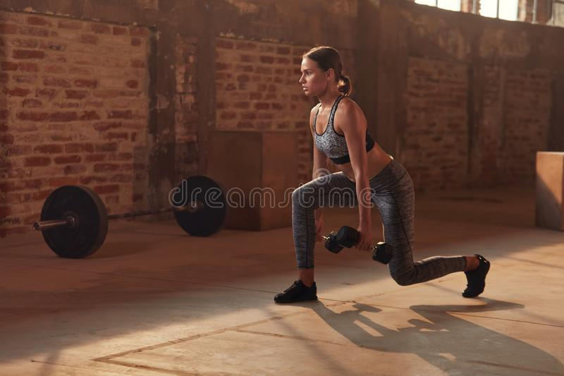 Sport woman doing leg exercise on fitness workout at gym stock image