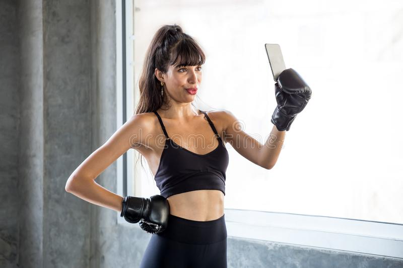 sport woman making selfie after exercise in  gym . fitness female in sportswear take a break from workout using smartphone taking stock photography