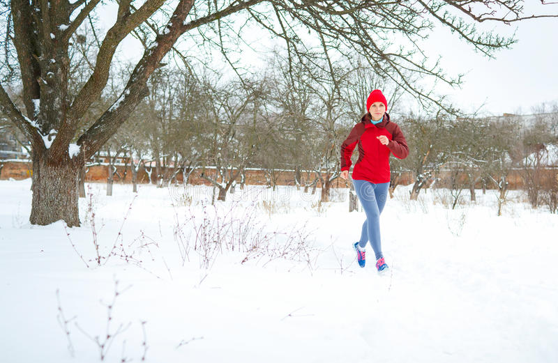 Sport woman running in winter royalty free stock photo