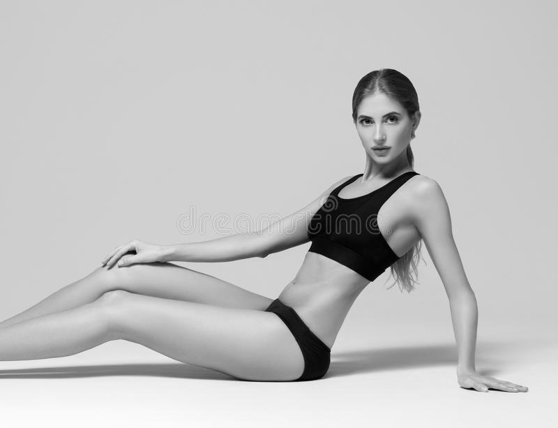 Sport. Woman sport body strong and beautiful black and white. St royalty free stock image