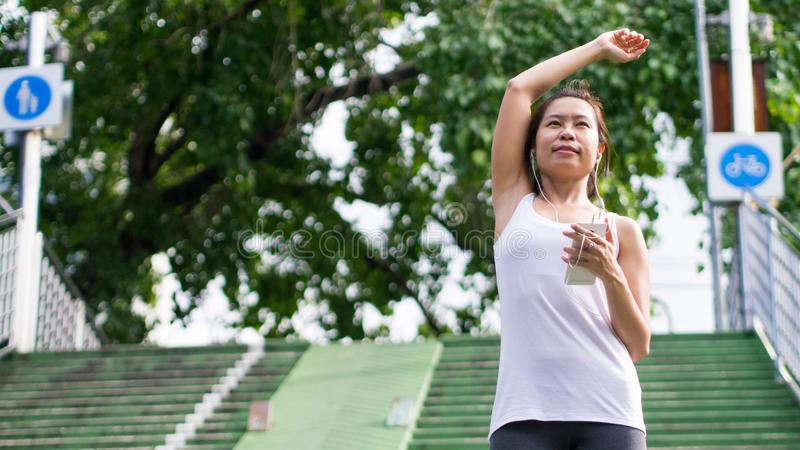 Sport woman stretching running in street park city urban background royalty free stock photos