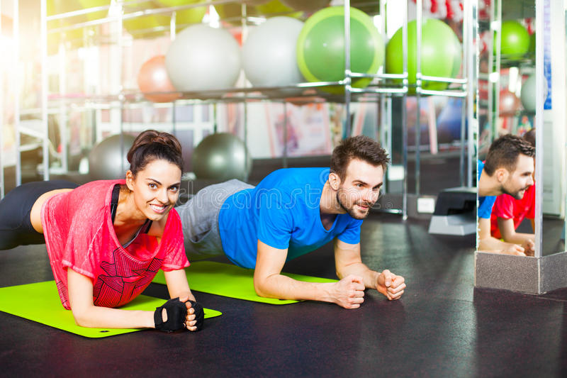 Sport - young fitness couple, crossfit training stock photos