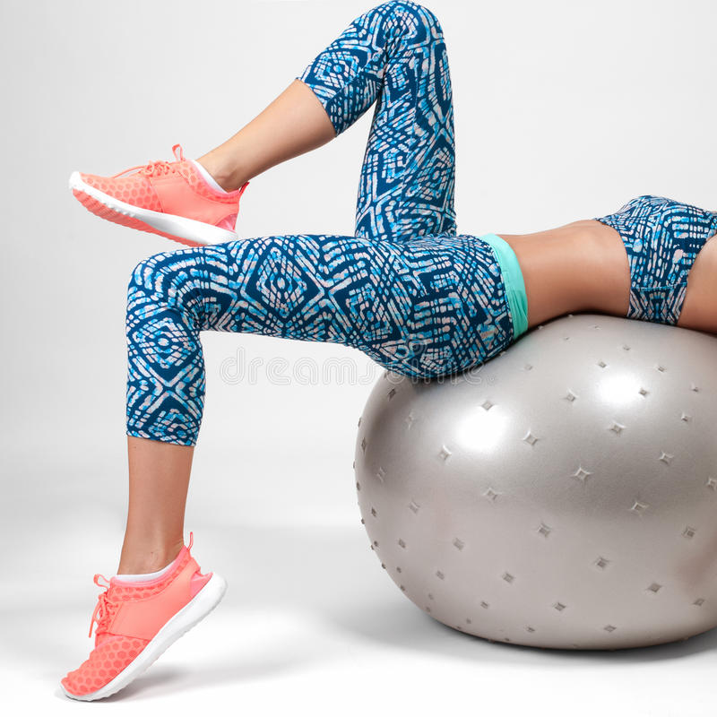 Sport young woman doing exercises on fitness ball royalty free stock photo