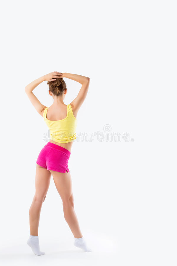 Sport young woman, silhouette studio shot over white background. On a neutral background royalty free stock images