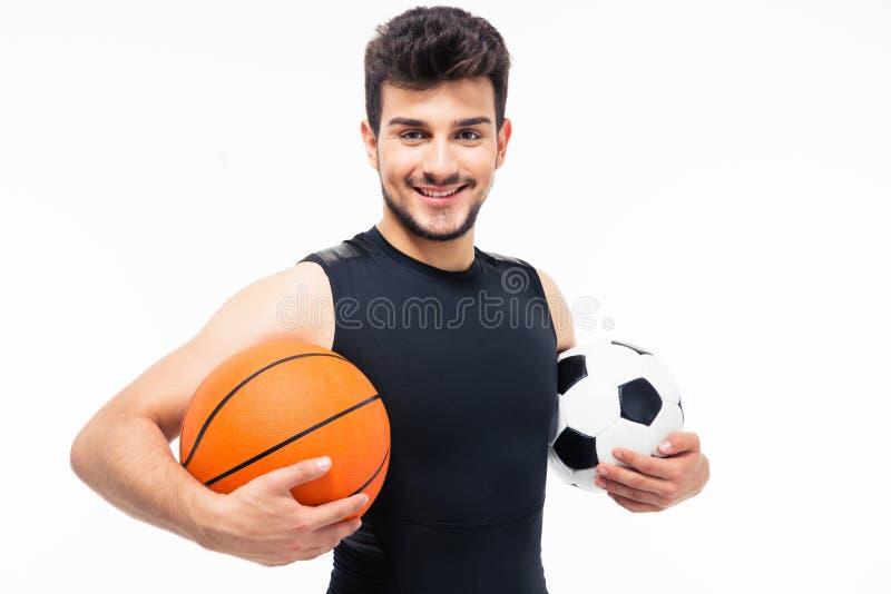 Sporta mężczyzna mienia piłki nożnej i koszykówki piłka zdjęcie royalty free