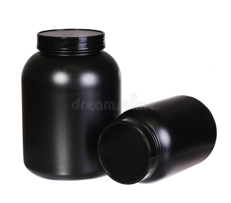 Sporta odżywianie, serwatki proteina i Gainer w Czarnych Plastikowych słojach, fotografia stock
