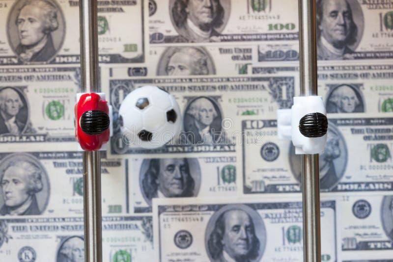 Sportar och pengar arkivbild