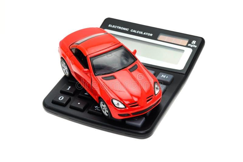 Sportauto gesetzt auf einen Taschenrechner stockfotos