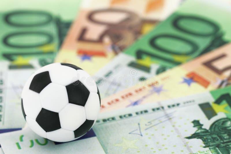 Sporten en geld stock foto