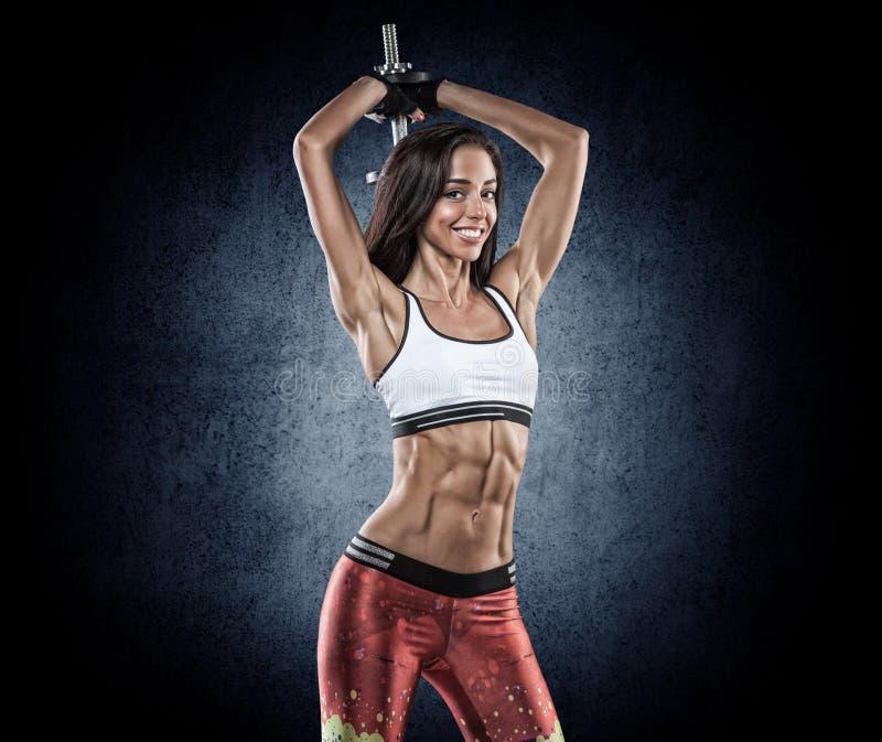 Download Sporten Jonge Vrouw Met Domoren Stock Foto - Afbeelding bestaande uit holding, energie: 54081604
