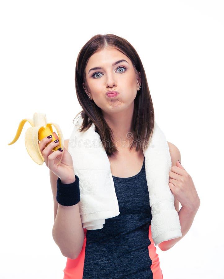 Sportenvrouw die banaan eten stock foto's