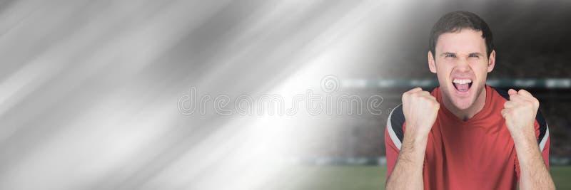 Sportfan som firar i stadion med övergång royaltyfria bilder