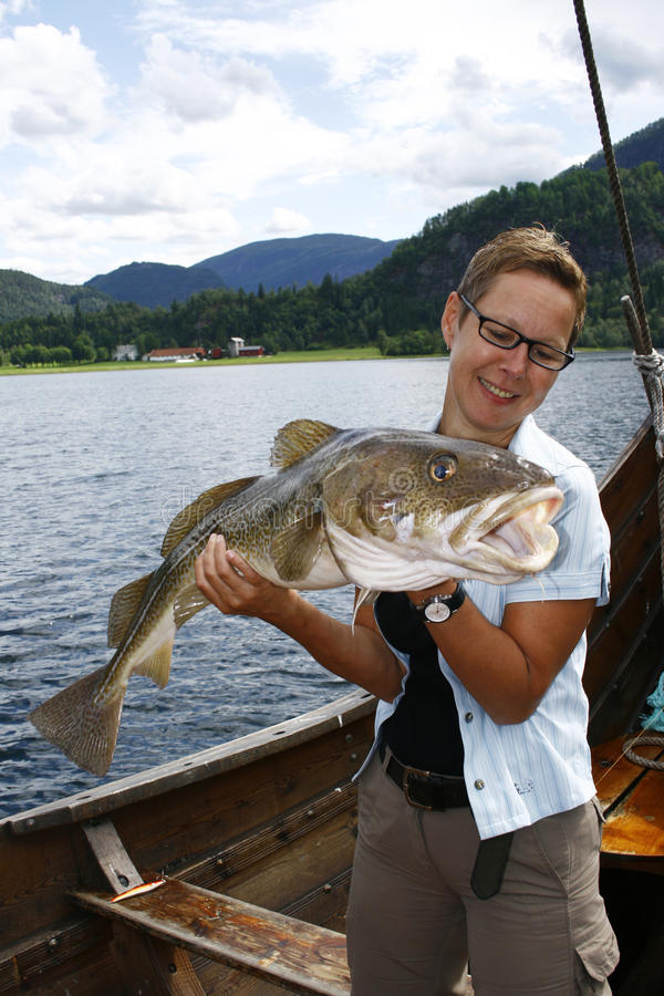 Download Sportfisher with big cod stock photo. Image of fisher - 10420056