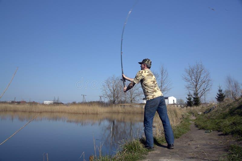 sportfiskareman royaltyfria foton