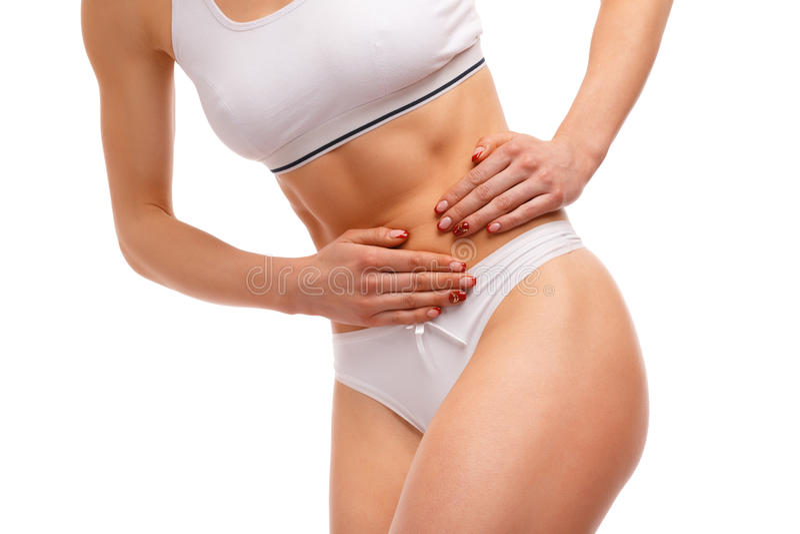 Sportfrau, die Bauchschmerzen hat lizenzfreies stockbild