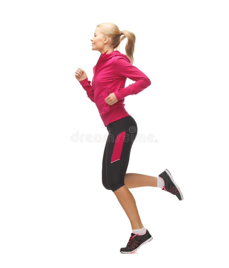 Sportieve of vrouw die lopen springen royalty-vrije stock foto's