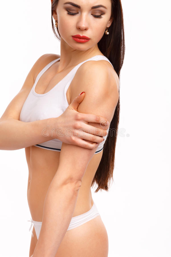 Sportieve vrouw die pijn in van haar hebben elleboog royalty-vrije stock afbeelding