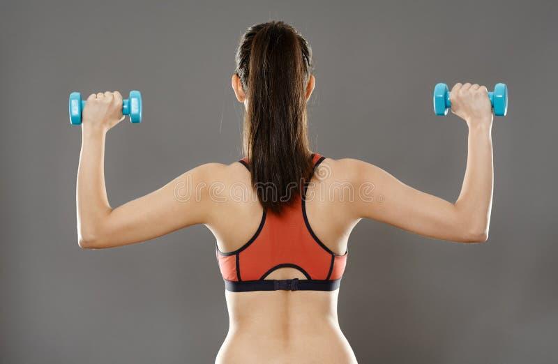 Sportieve Vrouwen Opheffende Domoren stock fotografie