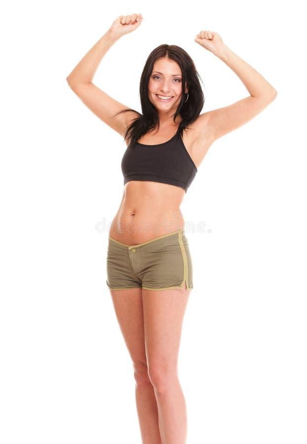 Sportig flicka för lycklig kvinnakondition över vit fotografering för bildbyråer