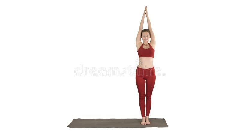 Sportig ung kvinna som g?r yoga?vning p? vit bakgrund royaltyfri bild