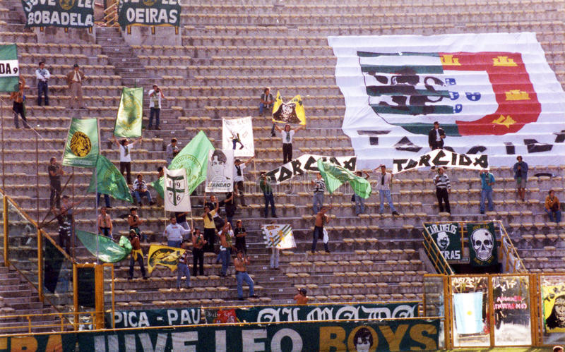 Sporting in bologna. Sporting lisbon fans in action at bologna in italy for a europe league football match stock images
