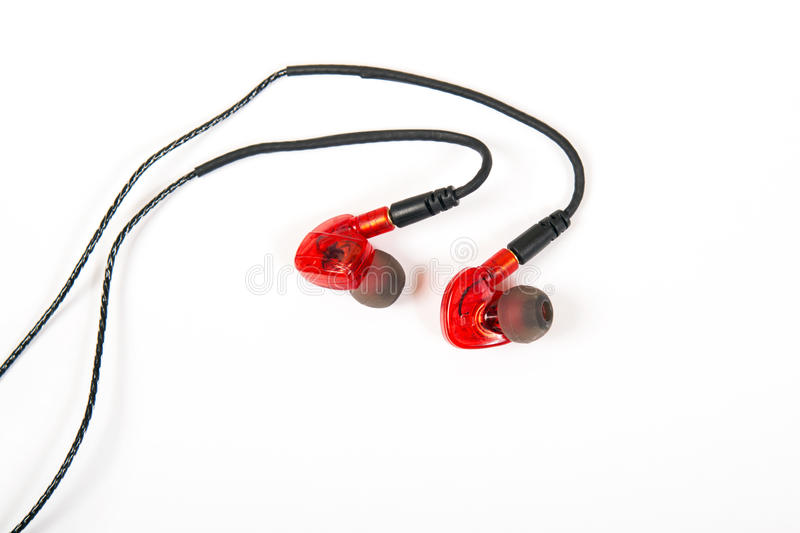Sporting earphones for sport trainings. With fixing behind an ear royalty free stock images