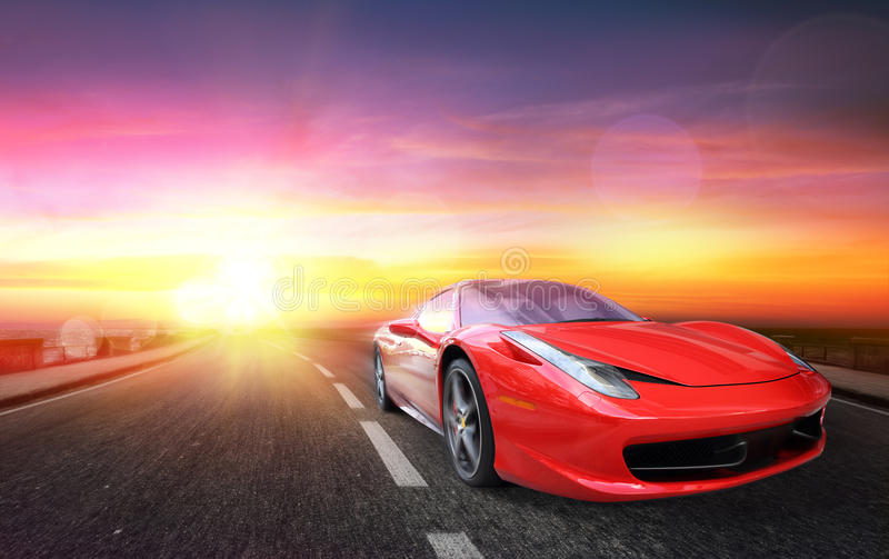 Sporting Race Car At Sunset. Race Car At Sunset- Red Car royalty free stock images