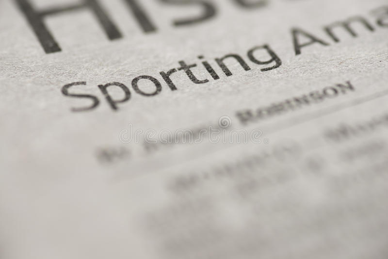 Sporting. Written sporting on real newspaper with shallow dof royalty free stock photo