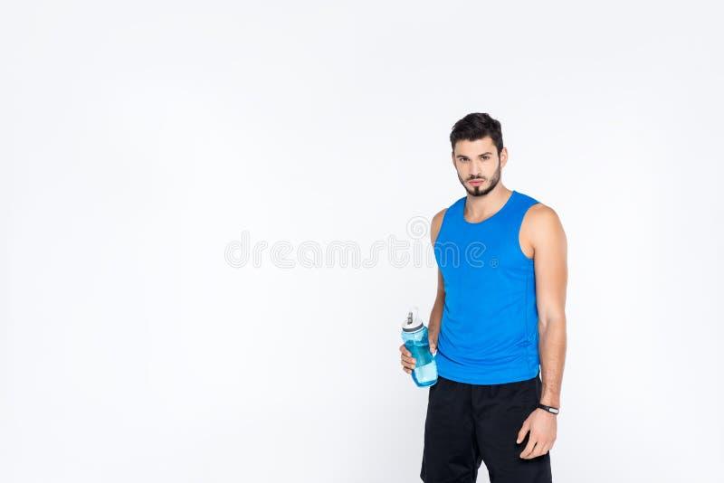sportive молодой человек с бутылкой фитнеса стоковое изображение rf