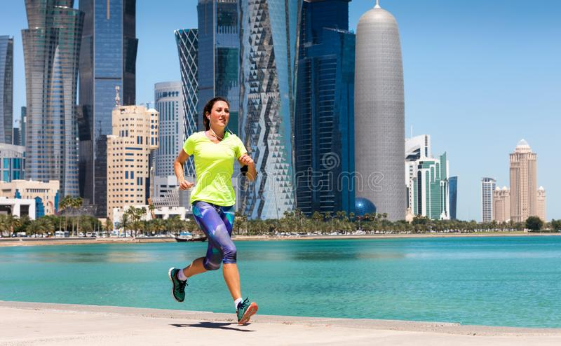Sportive female runner in Doha, Qatar royalty free stock photography