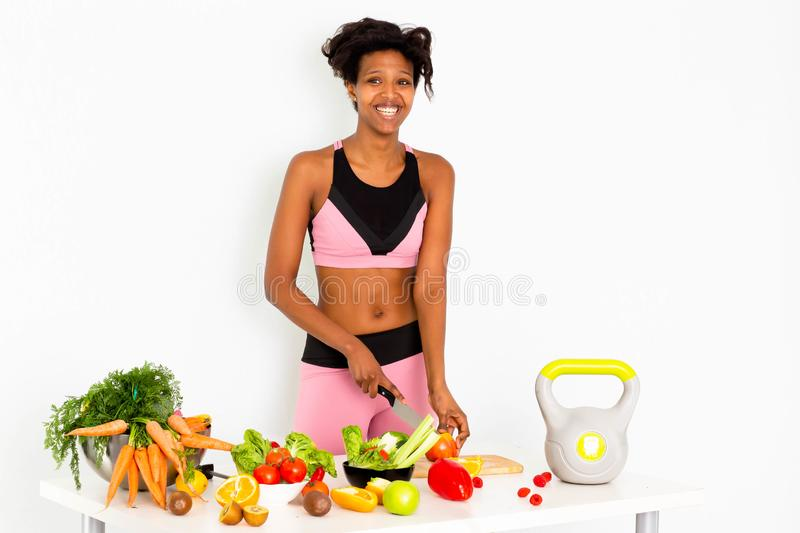 Sportive fitness, Black woman ,Home Fitness Black Woman. Sport fitness woman leggings,Young beautiful girl with with sports top and tights with fruits and royalty free stock photography