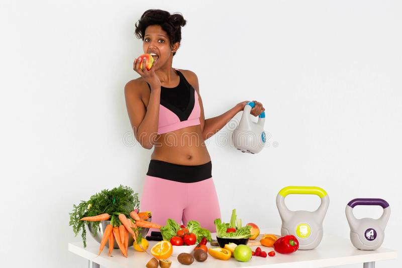 Sportive fitness Black woman ,Home Fitness Black Woman Training With Weights. Sport fitness woman leggings,Young beautiful girl with with sports top and tights royalty free stock images