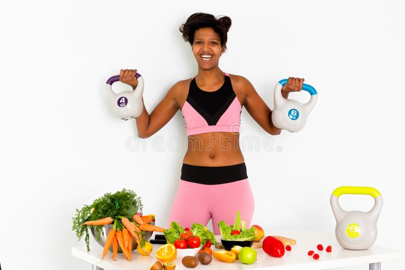 Sportive fitness, Black woman ,Home Fitness Black Woman Training With Weights. Sport fitness woman leggings,Young beautiful girl with with sports top and tights stock photography
