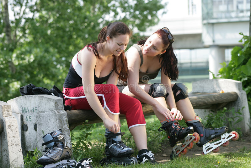Sportive friends sitting on a bench stock image