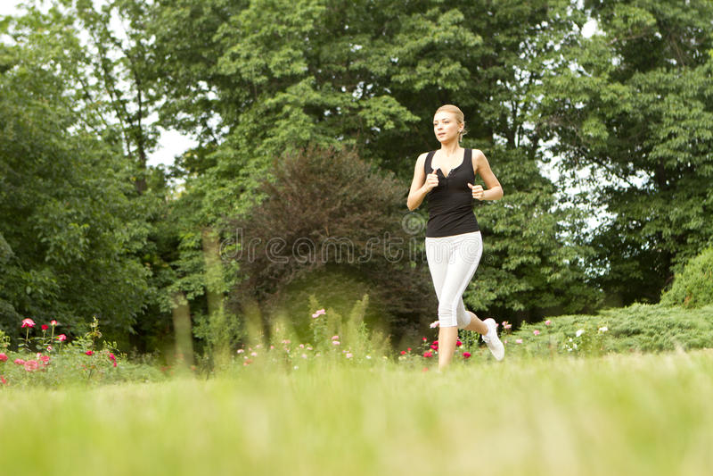 Sportive kobieta bieg obraz royalty free