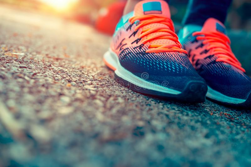 Sportive life concept. Closeup photo of a women`s running shoes, female on the workout in sunny day, life energy, health and body care, sportive life concept royalty free stock photography