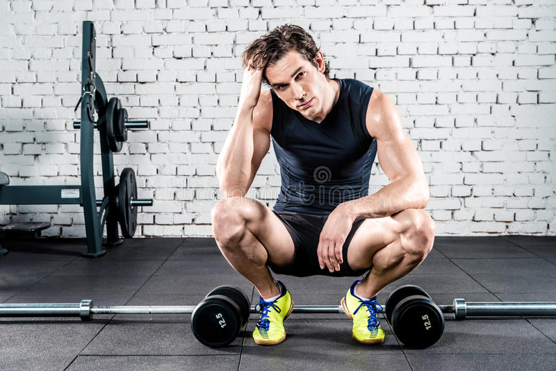 Sportive man in gym stock photo
