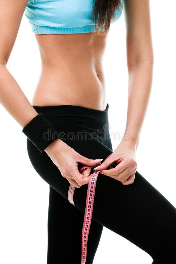 Download Sportive Woman Measures Her Leg Stock Image - Image: 28882247