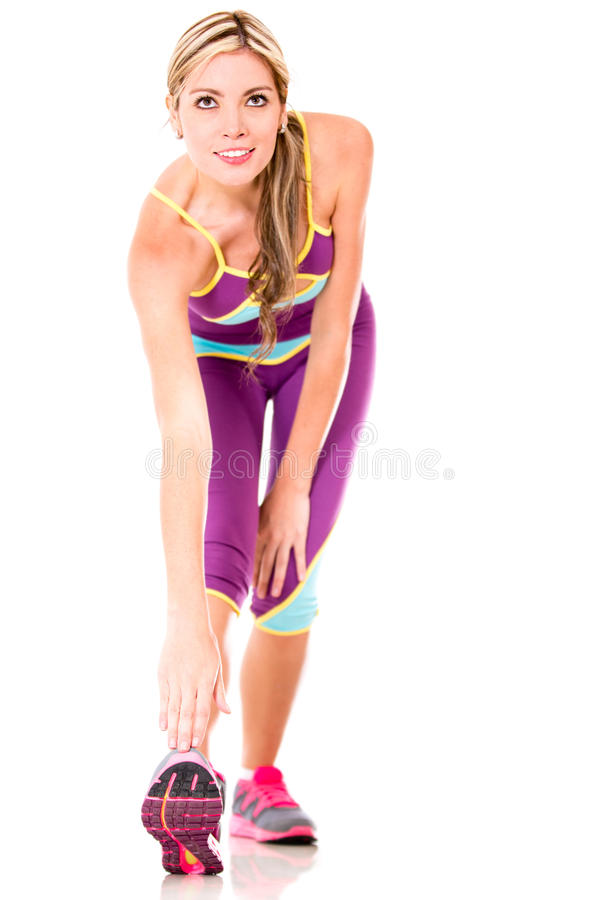 Download Sportive Woman Touching The Tip Of Her Shoe Stock Photo - Image: 27682432
