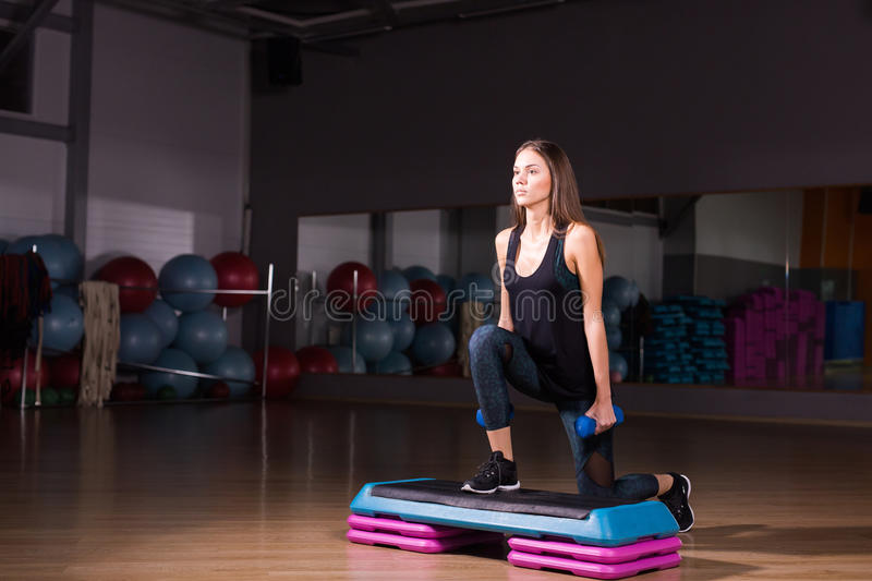Sportive young woman with beautiful athletic body doing exercises with dumbbells. Fitness, bodybuilding. Healthcare.  stock photo