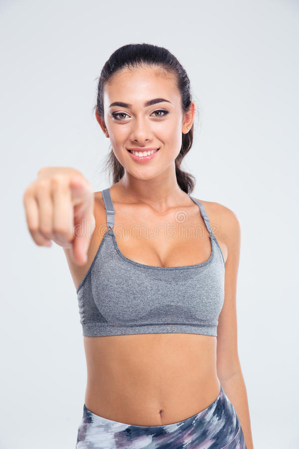 Sportkvinna som pekar fingret på kameran arkivbild