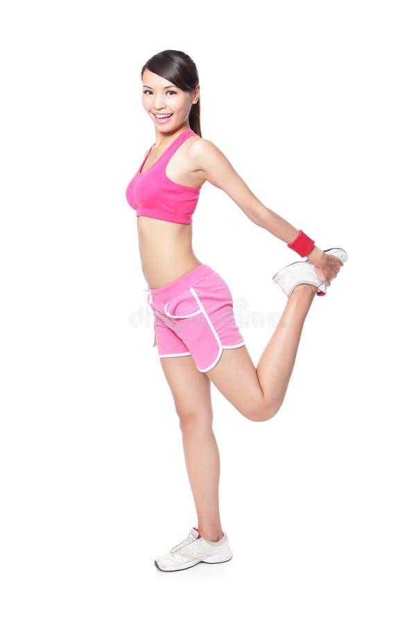Sportkvinna som värmer upp för sport arkivfoton