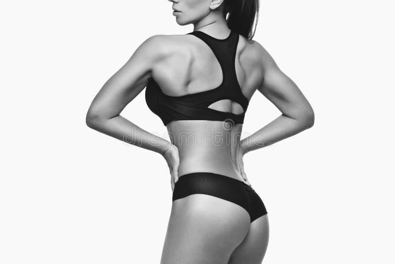 Sportliches Mädchen mit den Muskeln stockfotos