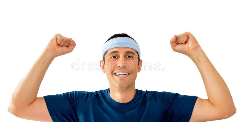 Betting in sport. Sportman with arms raised as symbol of success in sports royalty free stock photo