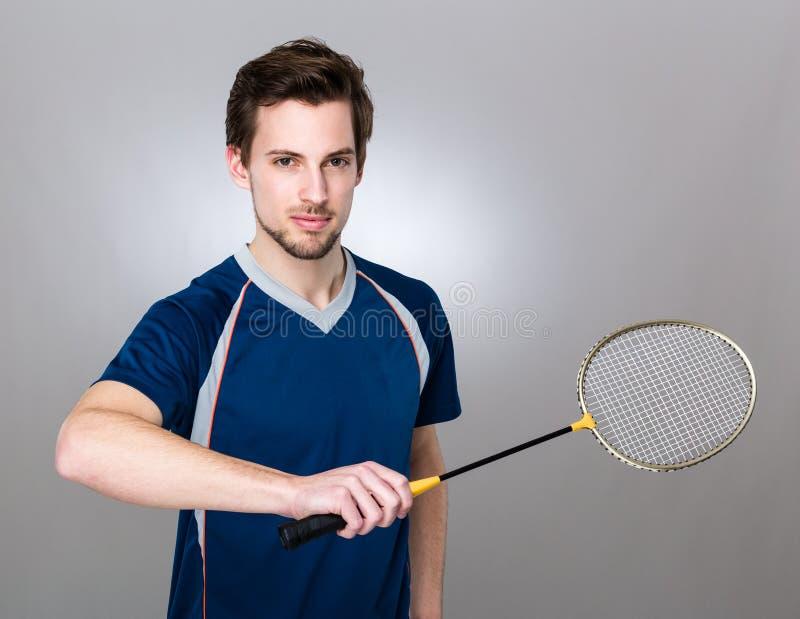 Sportmannspiel mit Badminton stockfotos