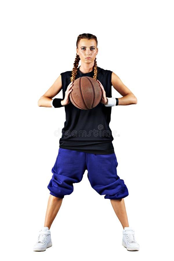 Sportmeisje met een geïsoleerd basketbal royalty-vrije stock foto's